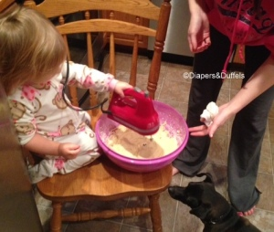 Using the mixer, which she was very happy about. The dog was even trying to sneak in and she forcefully told him no.